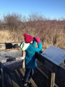 photos of child with binoculars in winter clothes