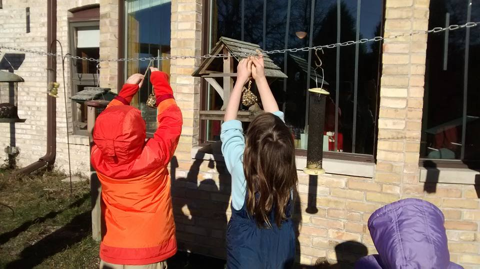 photos of kids putting up homemade bird feeders