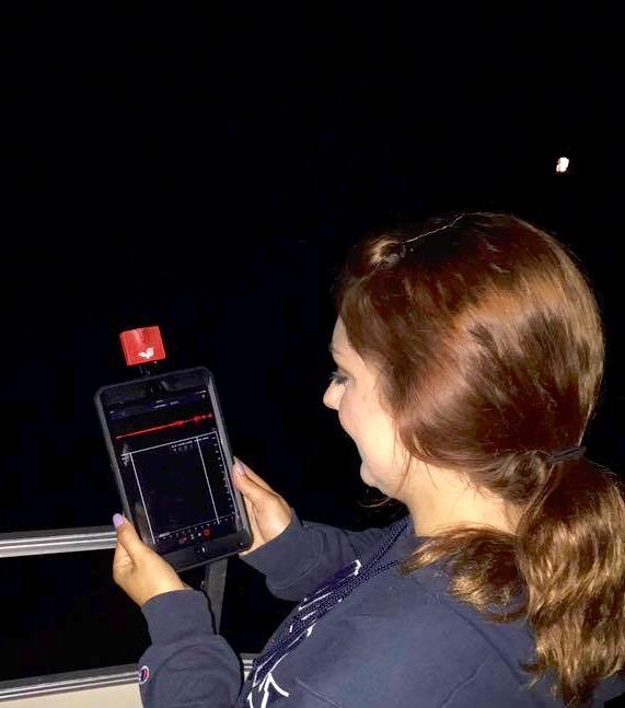 photo of girl using bat monitor device