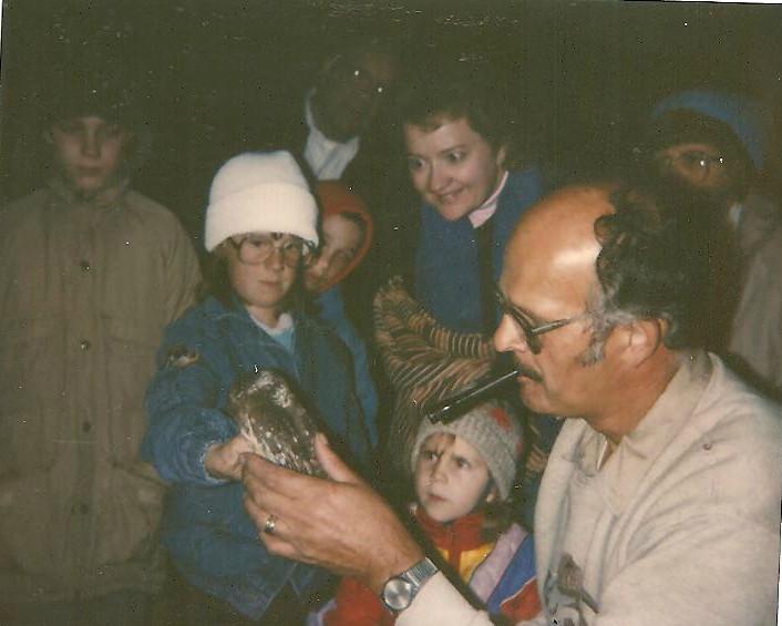 photo of Bernie Brouchoud banding saw-whet owls