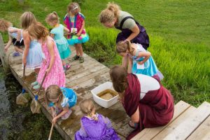 photo of kids and teacher learning about pond life