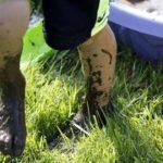 Camper with muddy feet