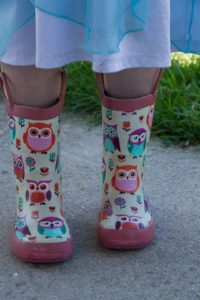 Photo of young camper wearing her hiking boots at Nature Princess summer camp
