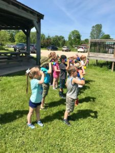 Little Wings campers learning how to use binoculars